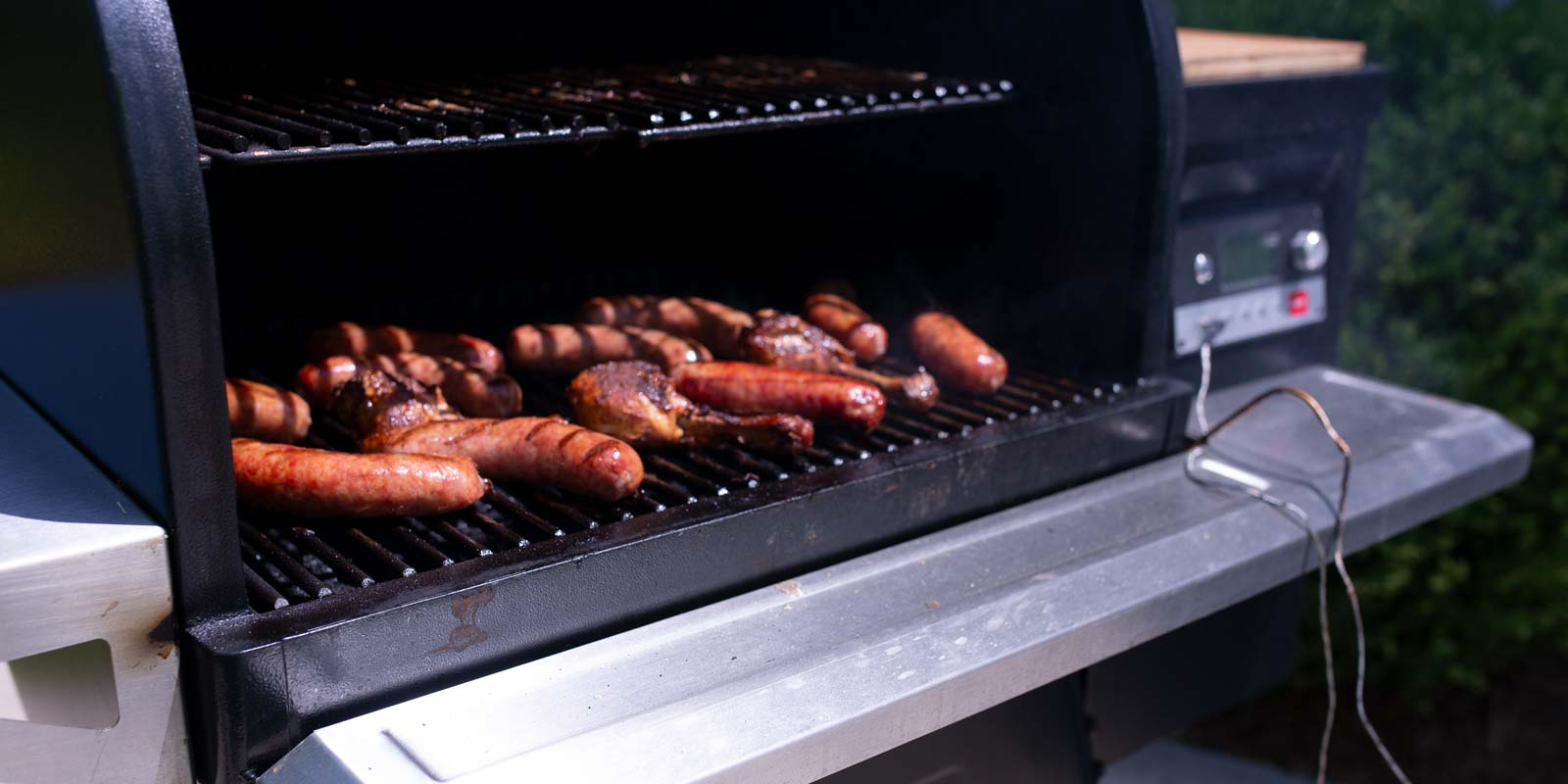 Hot dogs grilling on a traeger