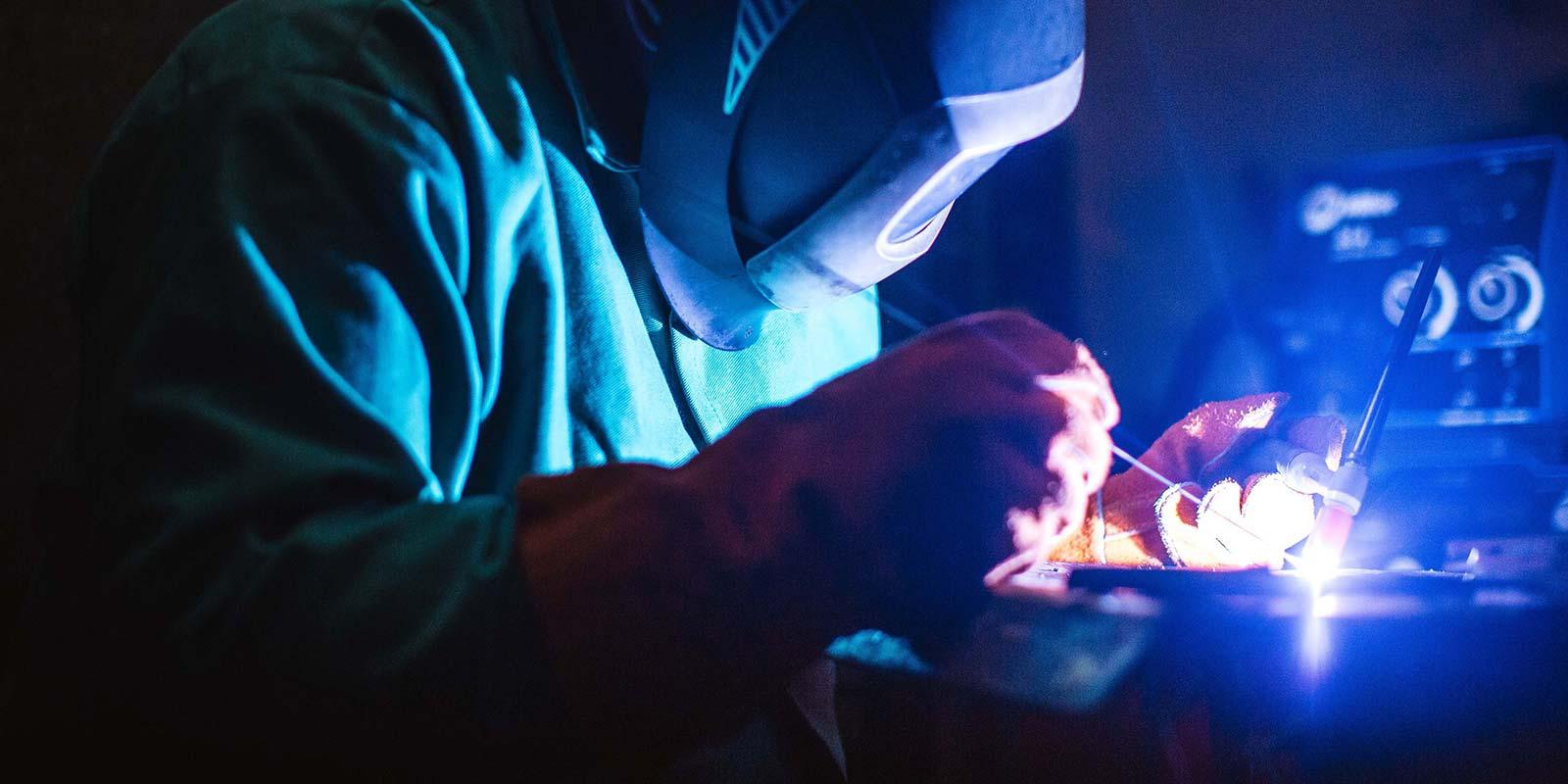 A Tekna team member welding